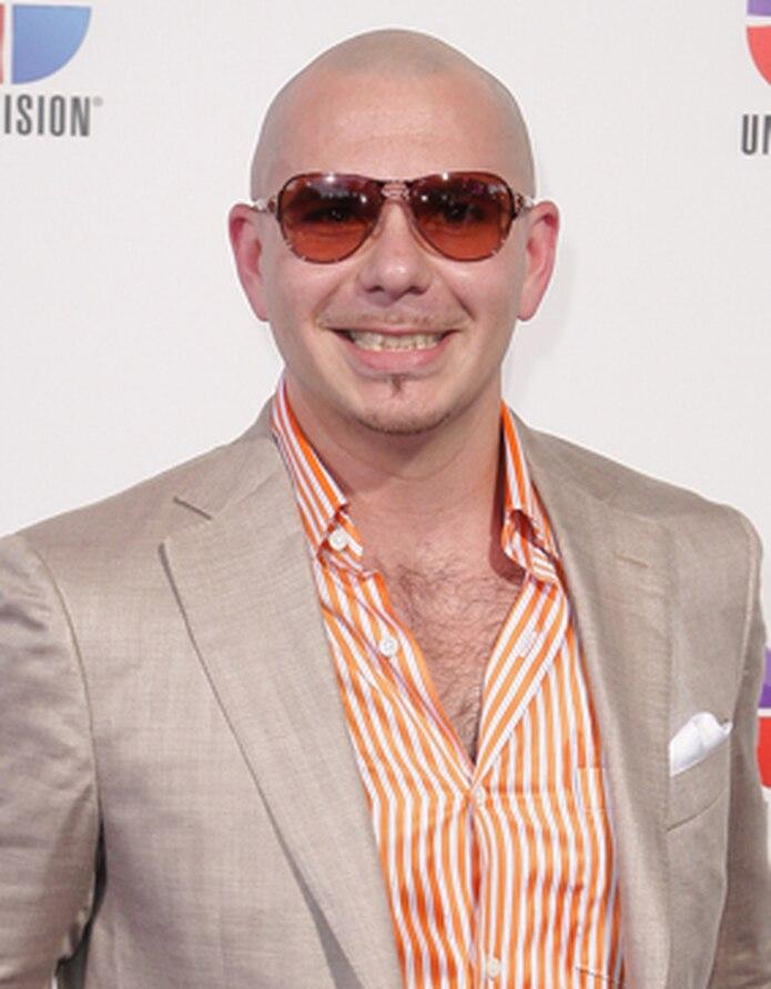Pitbull se ha destacado en la palestra musical por no sólo utilizar pistas musicales ya conocidas y crear nuevas versiones con sus picantes letras sino también por sus dúos  ocn figuras internacionales como Jennifer López, Marc Anthony, Enrique Iglesias, T-Pain, Usher y Lumidee. (Archivo)