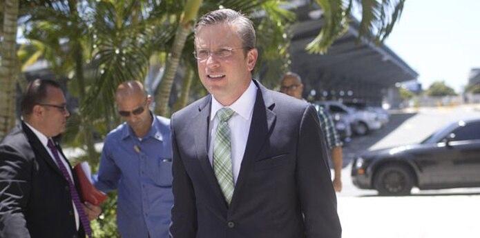García Padilla acordó junto a los legisladores populares que por los próximos nueve meses se aumentará a 11.5% el IVU, de los cuales 1.5% pasará a los municipios. (Archivo)