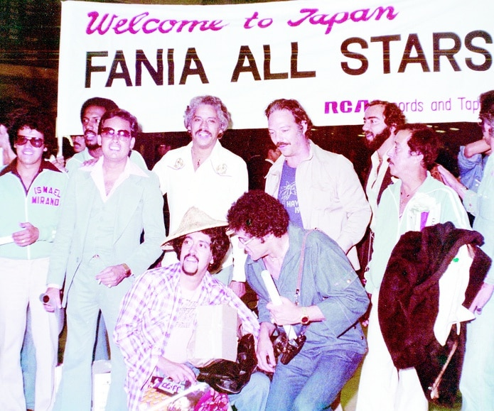 Presented with the stars of Fania in Japan.  From left, Ismail Miranda, Roberto Rona (back), Ismail Quintana, Johnny Pacheco, Larry Harlow, Jerry Masoussi, San Diego Callen and Jose Flores.  In front, Nicky Murrero (hat) and Izzy Sanabria.  -----