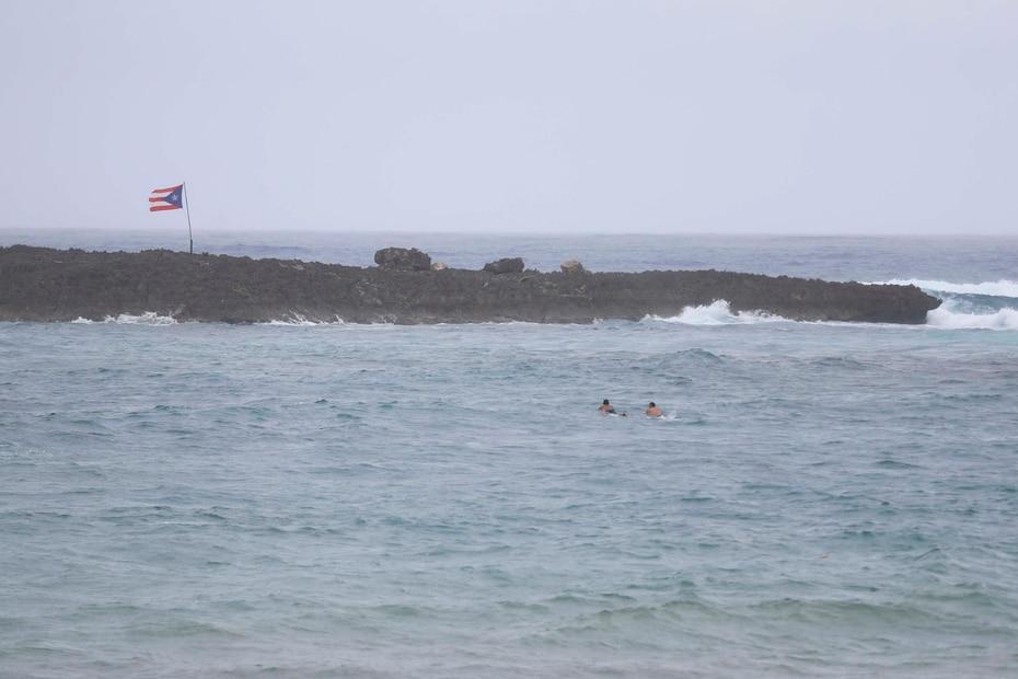 Surfers in El Escambrón, San Juan.