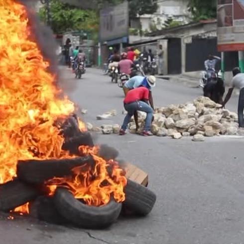 Tensa la capital haitiana tras enfrentamientos entre policías y militares