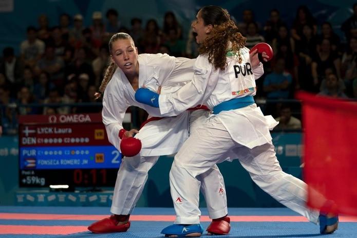 Janessa Fonseca (derecha) cerró con una quinta posición en la división de +59 kilogramos del karate femenino. (Suministrada)