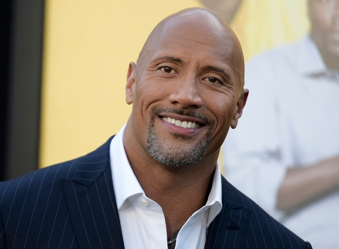 """FILE - In this June 10, 2016 file photo, Dwayne Johnson attends the premiere of his film, """"Central Intelligence"""" in Los Angeles. Johnson was named """"Sexiest Man Alive"""" by People magazine on Nov. 15, 2016. (Photo by Richard Shotwell/Invision/AP, File)"""