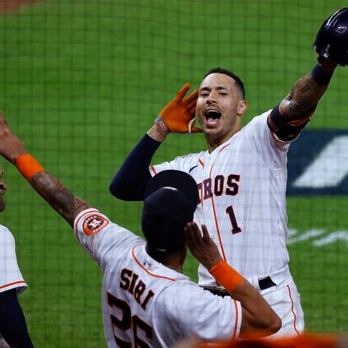 Altuve y Correa jonronearon y los Astros de Houston se llevaron el primero