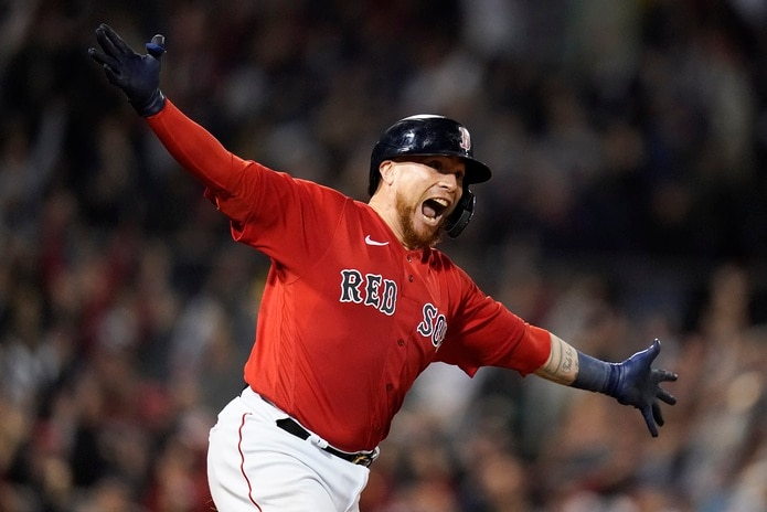 Boston Red Sox Christian Vazquez reacts after hitting a walk-off home run against the Tampa Bay Rays during the thirteenth inning during Game 3 of a baseball American League Division Series, Sunday, Oct. 10, 2021, in Boston. The Red Sox won 6-4. (AP Photo/Charles Krupa)