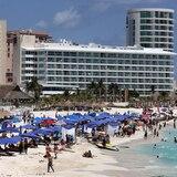 México se queja de que turistas no usan mascarillas
