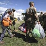 Refugiados comienzan a llegar al campamento militar de Guánica