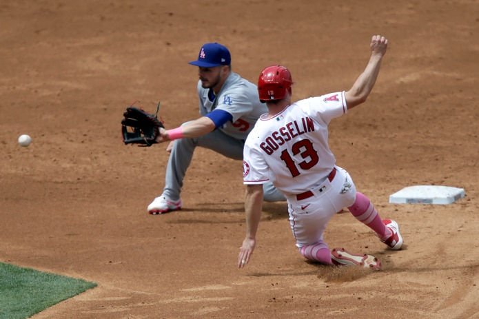Dodgers second baseman Gavin Lux waits for the throw to put out Phil Gosselin of the Angels during a steal attempt.