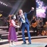 Niña le roba el corazón a Marc Anthony en pleno concierto
